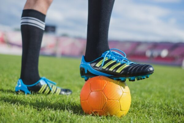Classification of Football Cleats Based on the Ground